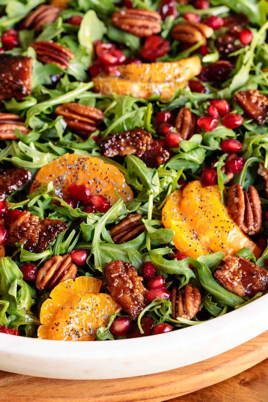 Extreme closeup photo of a Cranberry Clementine Arugula Salad.