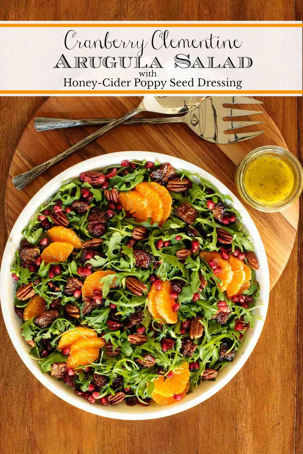 This Cranberry Clementine Arugula Salad also includes butter-toasted pecans, candied bacon, ruby-red pomegranate seeds and a delicious Honey-Cider Dressing. #arugulasalad, #arugulaclementinesalad, #fallsalad, #holidaysaiad, #Christmassalad