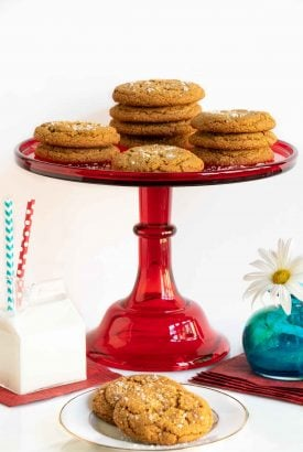 Vertical photo of Crinkly Crackly Butterscotch Cookies on a red glass pedestal serving plate.