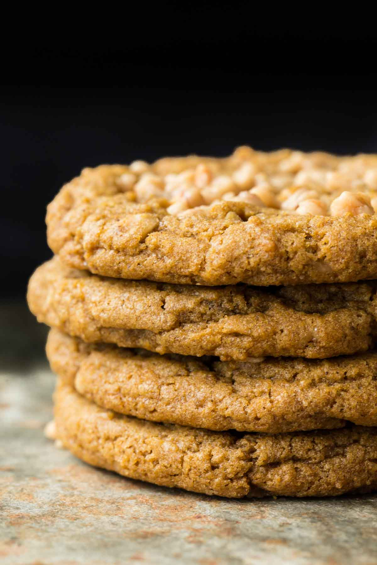Vertical closeup photo of a stack of Crispy Chewy Pumpkin Cookies.