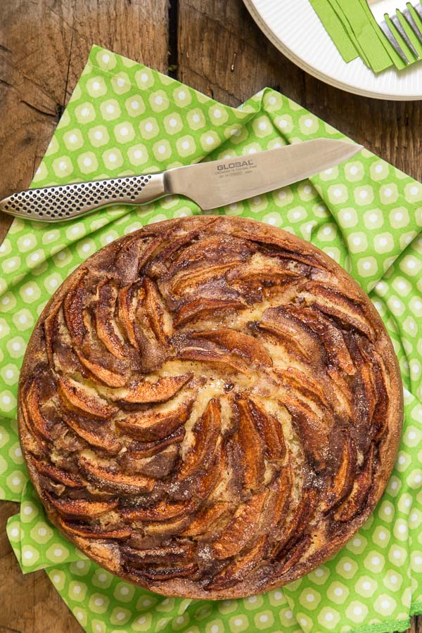 Overhead picture of Danish Apple Cake on a green and white napkin