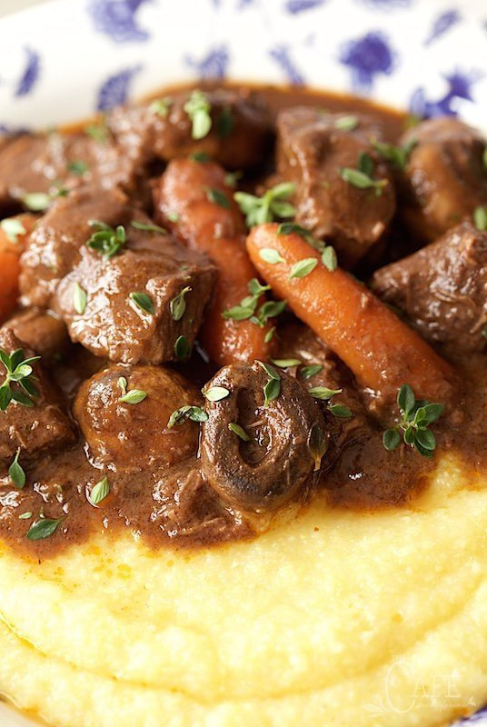 Beef Daube - it's beef stew, Provencal style! Made with red wine, rosemary, thyme and bay leaves, it's slow roasted till all the flavors meld together and the beef is melt-in-your-mouth tender and crazy delicious! www.thecafesucrefarine.com