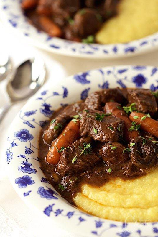 Close up picture of Provencal Beef Stew with Polenta in a blue and white bowl