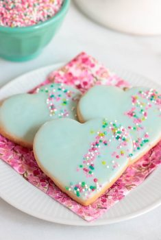 Vertical photo of Valentine Shortbread Heart Cookies on a pink napkin.