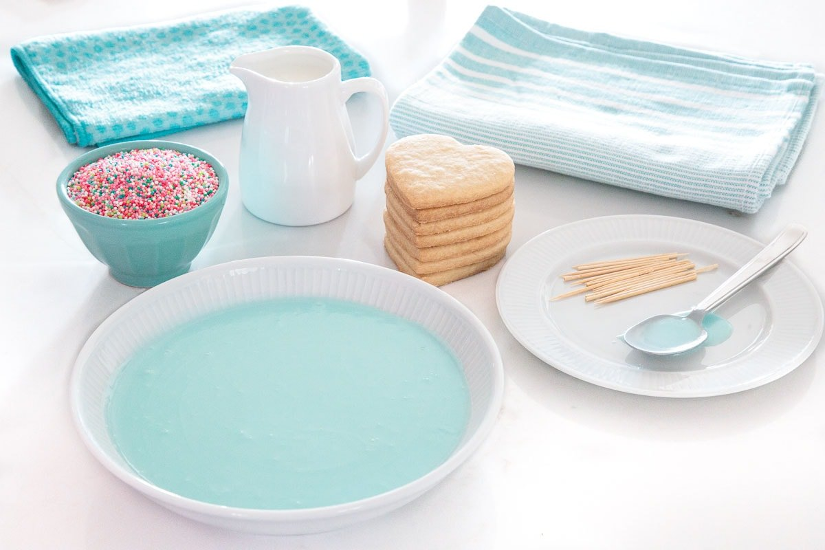 Photo of the materials needed to create Dip, Drip and Flip Shortbread Valentine Cookies.