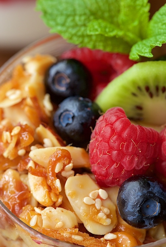 Close-up view of Double Almond Paleo Granola with fresh fruit.
