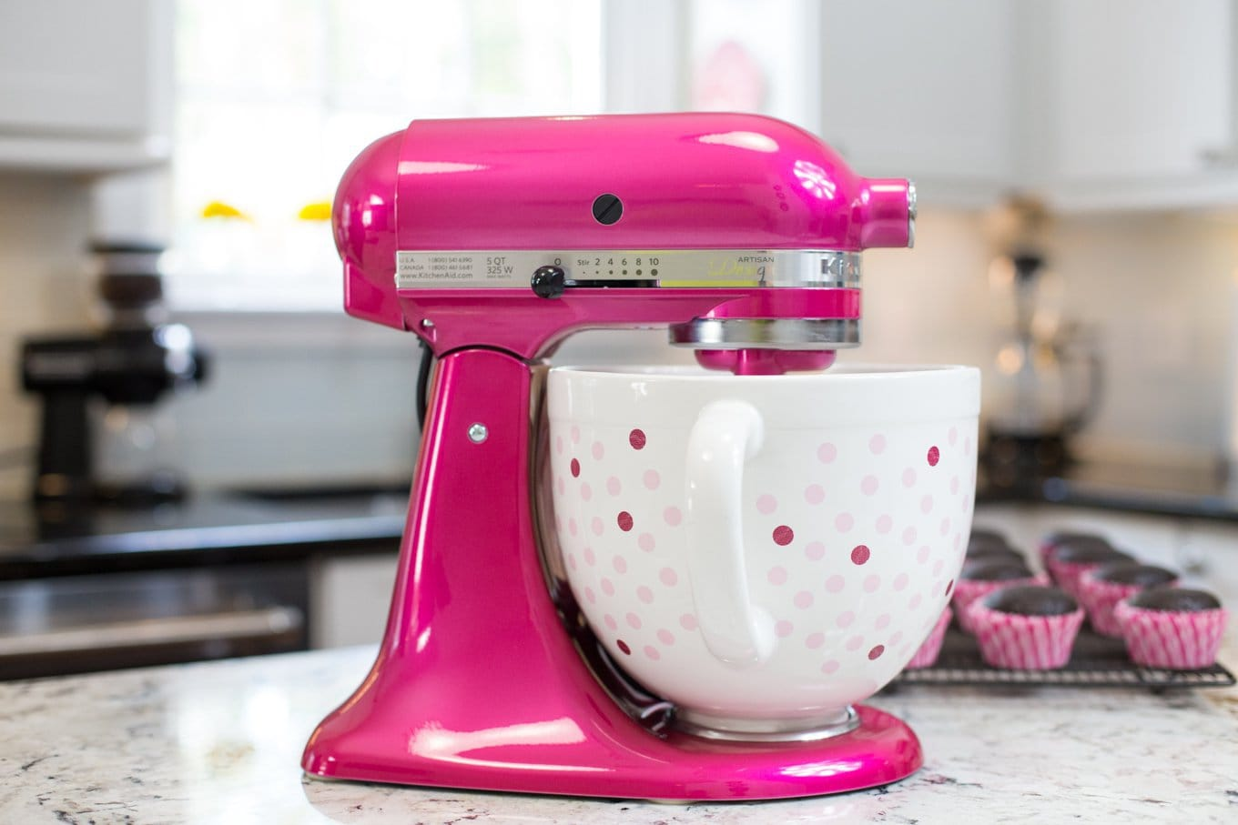 This KitchenAid Raspberry Ice Artisan Mixer with Polka Dot Bowl was created by KitchenAid to help promote awareness and help fund the fight against breast cancer through the Susan Komen Foundation thecafesucrefarine.com