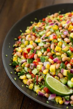 Vertical close up picture of Easy Black-Eye Pea Salad on a black plate
