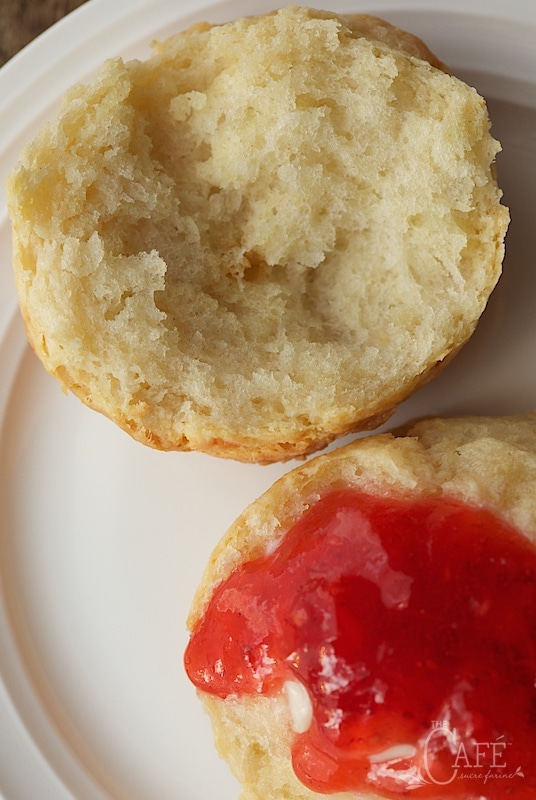Overhead closeup of Ridiculously Easy Buttermilk Biscuit spread with strawberry jam - thecafesucrefarine.com