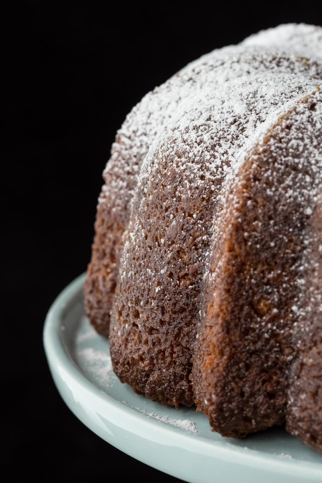 Closeup photo of the side of an Easy Carrot Cake with Buttermilk Glaze.