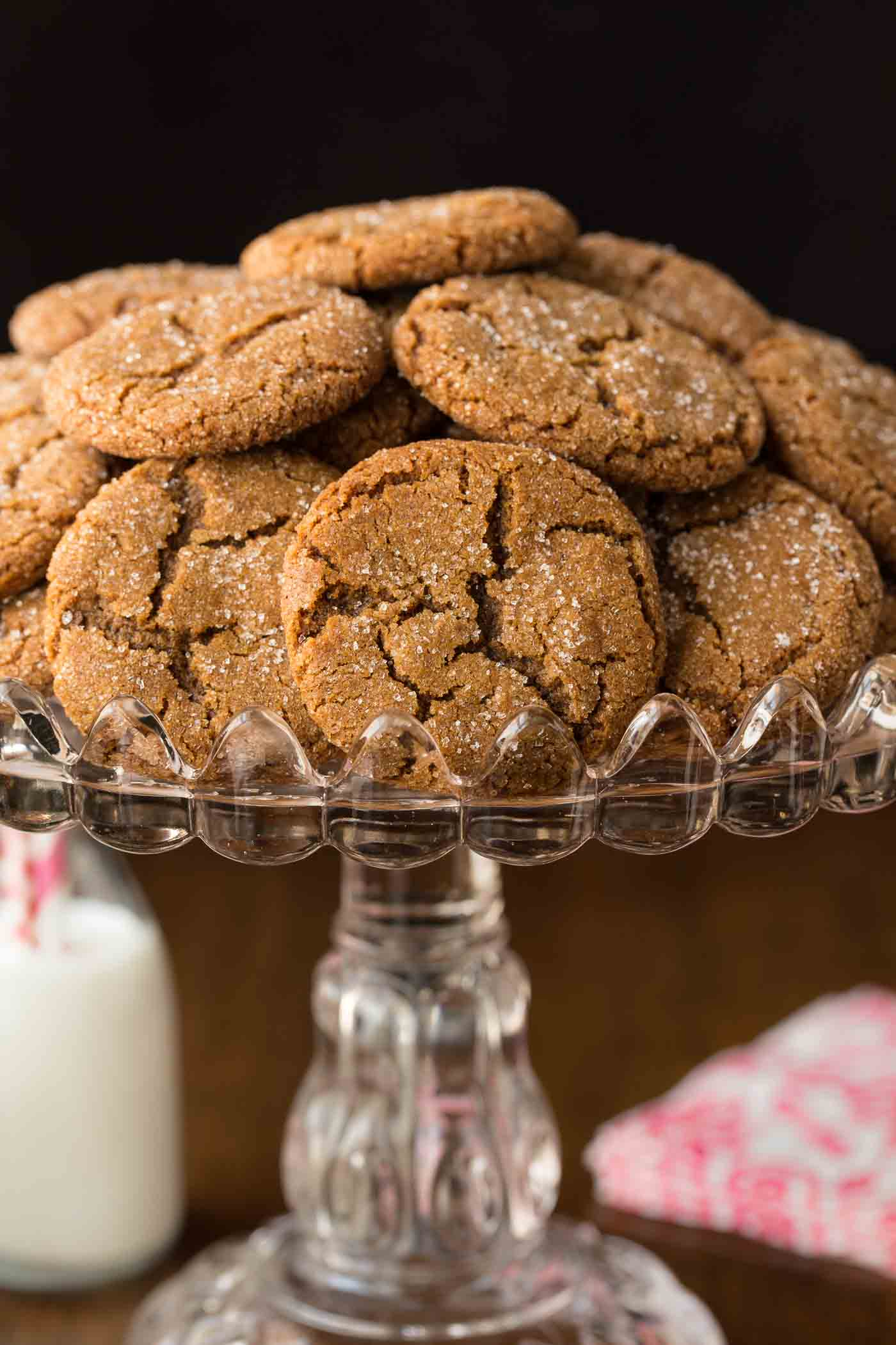 Vertical photo of Easy Molasses Ginger Cookies on a glass pedestal cake stand.