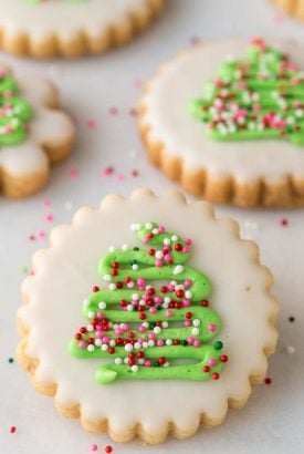 Overhead picture of decorated christmas cookies on a white background
