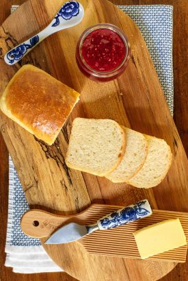 Overhead picture of brioche bread on a wooden cutting board