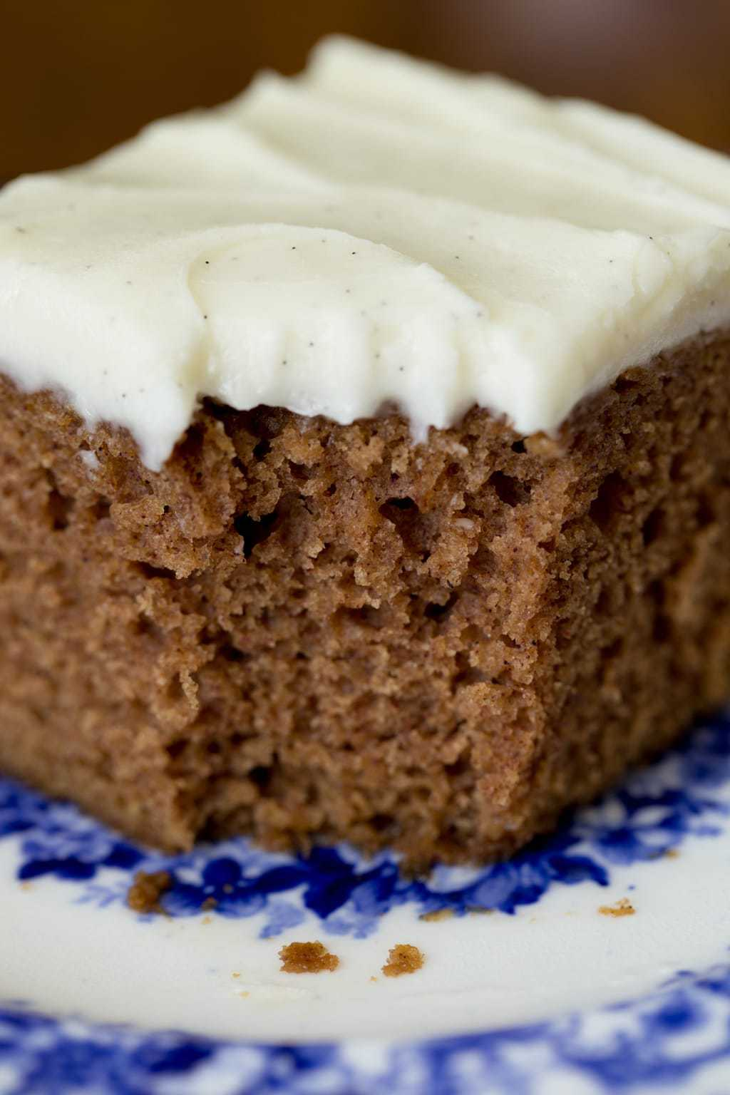 Closeup photo of a piece of Easy Gingerbread Cake with Vanilla Bean Icing.