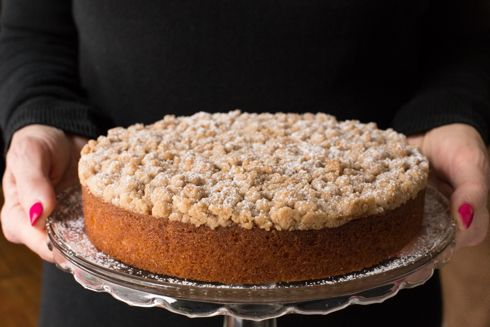 Topped with a sweet, buttery crumble, this Easy Overnight Coffee Cake is super moist and perfect for holidays and lazy weekends. www.thecafesucrefarine.com