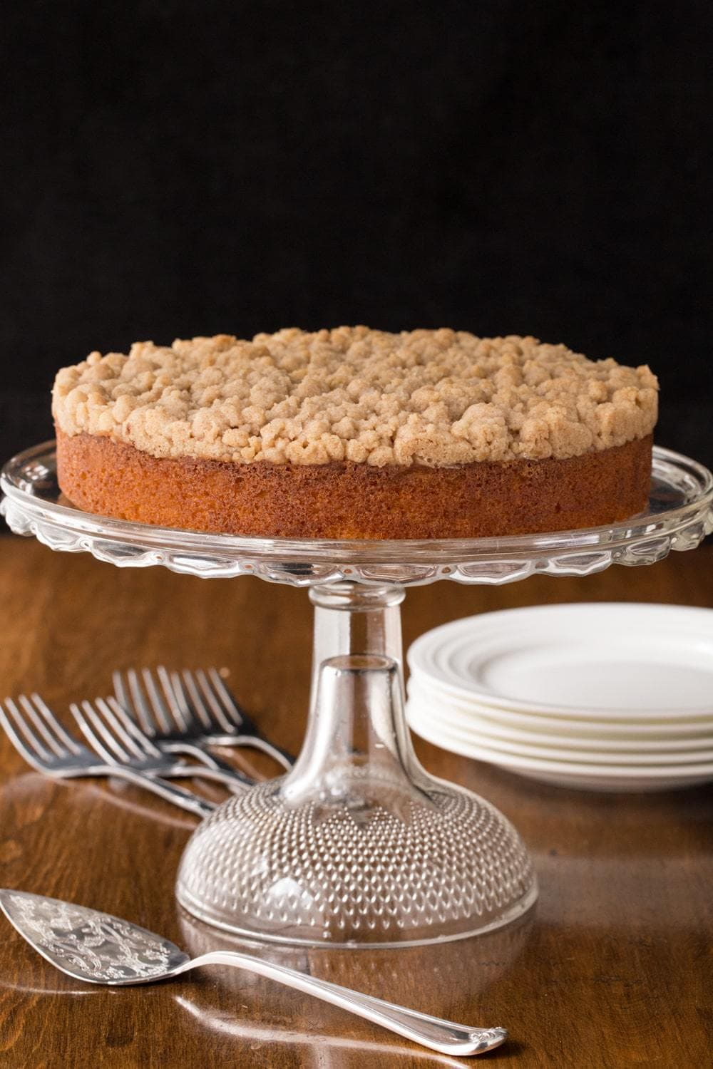 Topped with a sweet, buttery crumble, this Easy Overnight Coffee Cake is super moist and perfect for holidays and lazy weekends. thecafesucrefarine.com