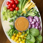 Overhead picture of Easy Peanut Sauce with fresh veggies