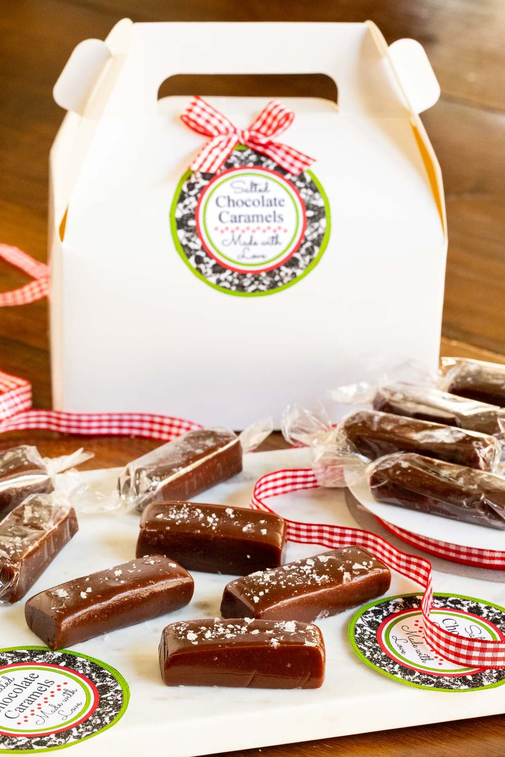Vertical photo of Easy Salted Chocolate Caramels including custom gift labels and boxes.
