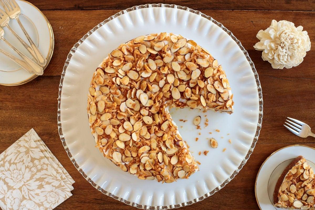 Horizontal overhead photo of an Easy Buttermilk Butter Crunch Cake on a white glass serving platter.
