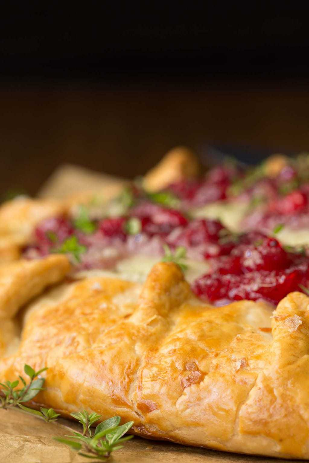 Closeup photo of the side of an Easy Turkey Dinner Galette with a garnish of thyme.