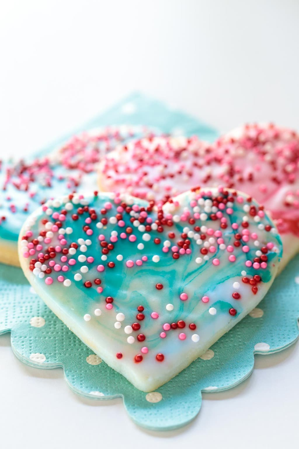 Overhead photo of Easy Decorated Valentine's Cookies on a turquoise dotted napkin.