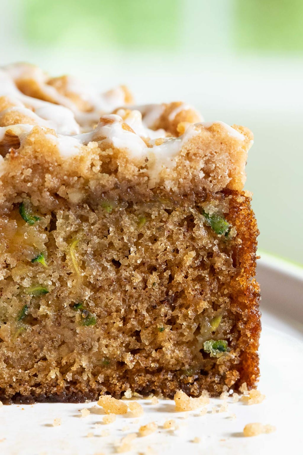 Extreme closeup vertical photo of the inside of an Easy Zucchini Crumb Cake.