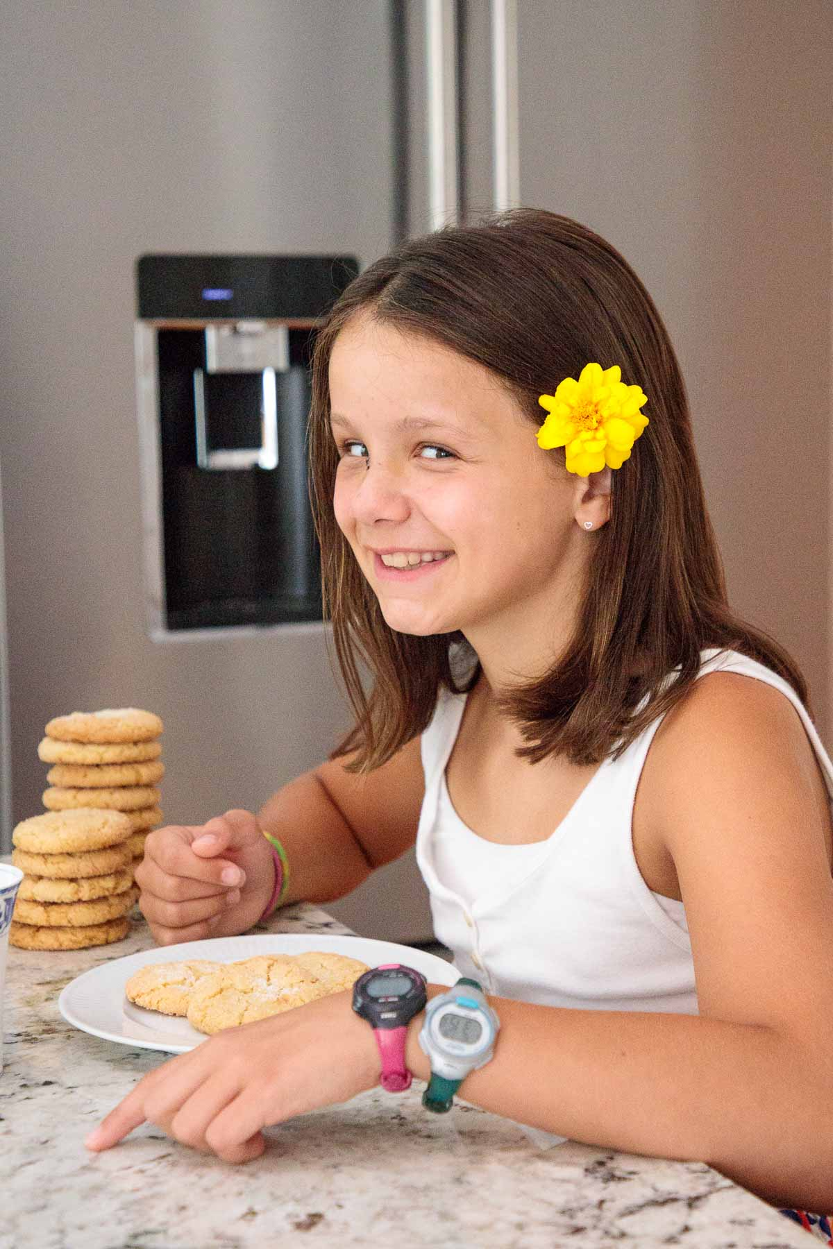 Photo of Elle enjoying her Lemon Coconut Sugar Cookies.
