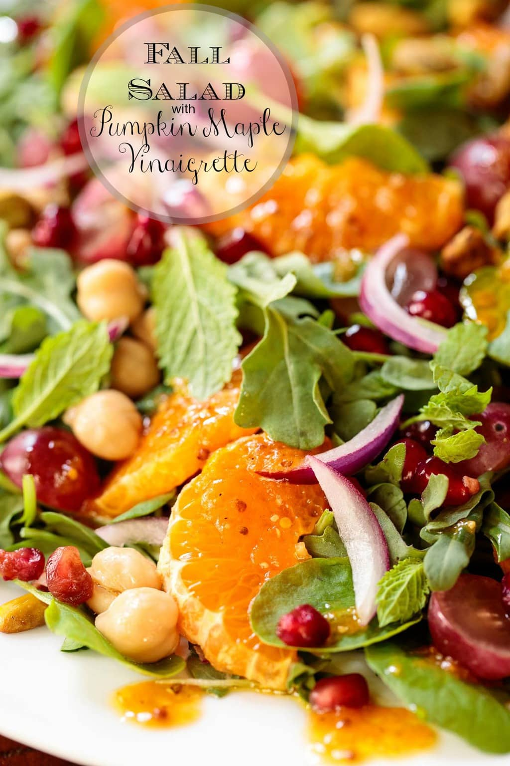 This vibrant fall salad is the perfect way to embrace autumn. It's with loaded healthy, seasonal ingredients and a fabulous pumpkin dressing. #fallsalad, #healthydinner, #healthysalad, #clementinesalad, #redgrapes, #arugularsalad, fallsaladdressing