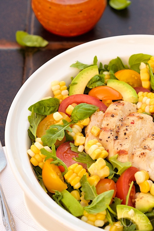 A vertical closeup of Farmer's Market Grilled Chicken Salad in a shallow white bowl.