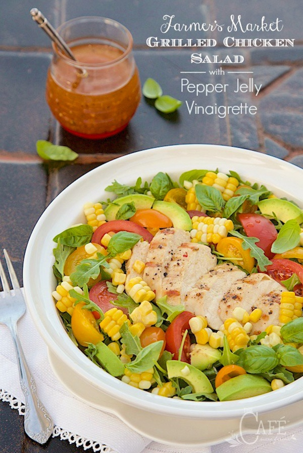 A vertical image with text of Farmer's Market Grilled Chicken Salad in a shallow white bowl with dressing nearby.