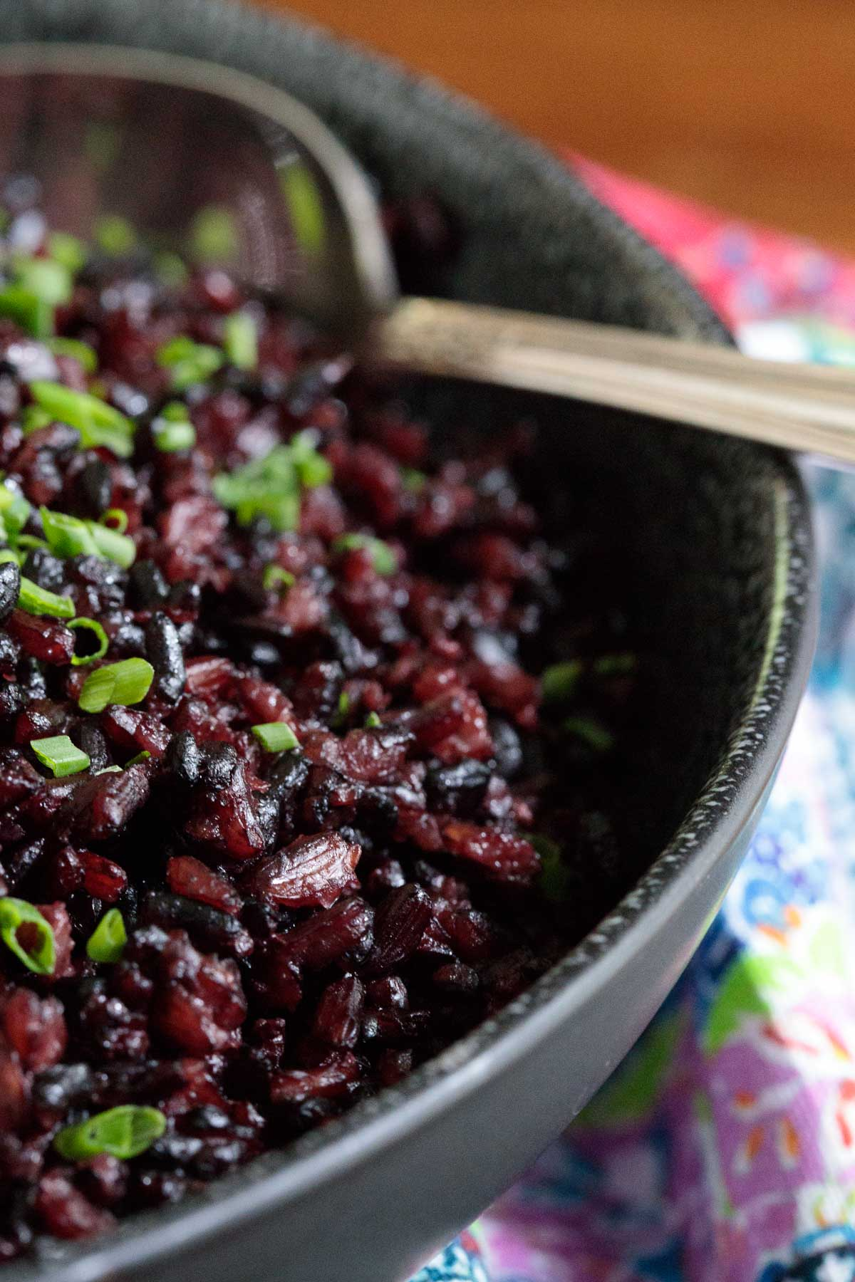 Closeup photo of a black serving bowl filled with black rice for the post - How to Cook Black Rice.