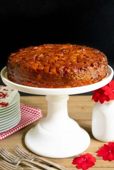 Vertical picture of French Caramel Apple Cake on a white cake stand