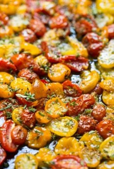 Garlic and Herb Roasted Tomatoes - these incredibly flavorful roasted tomatoes are wonderful in salads, pasta dish on pizzas, sandwiches, etc.