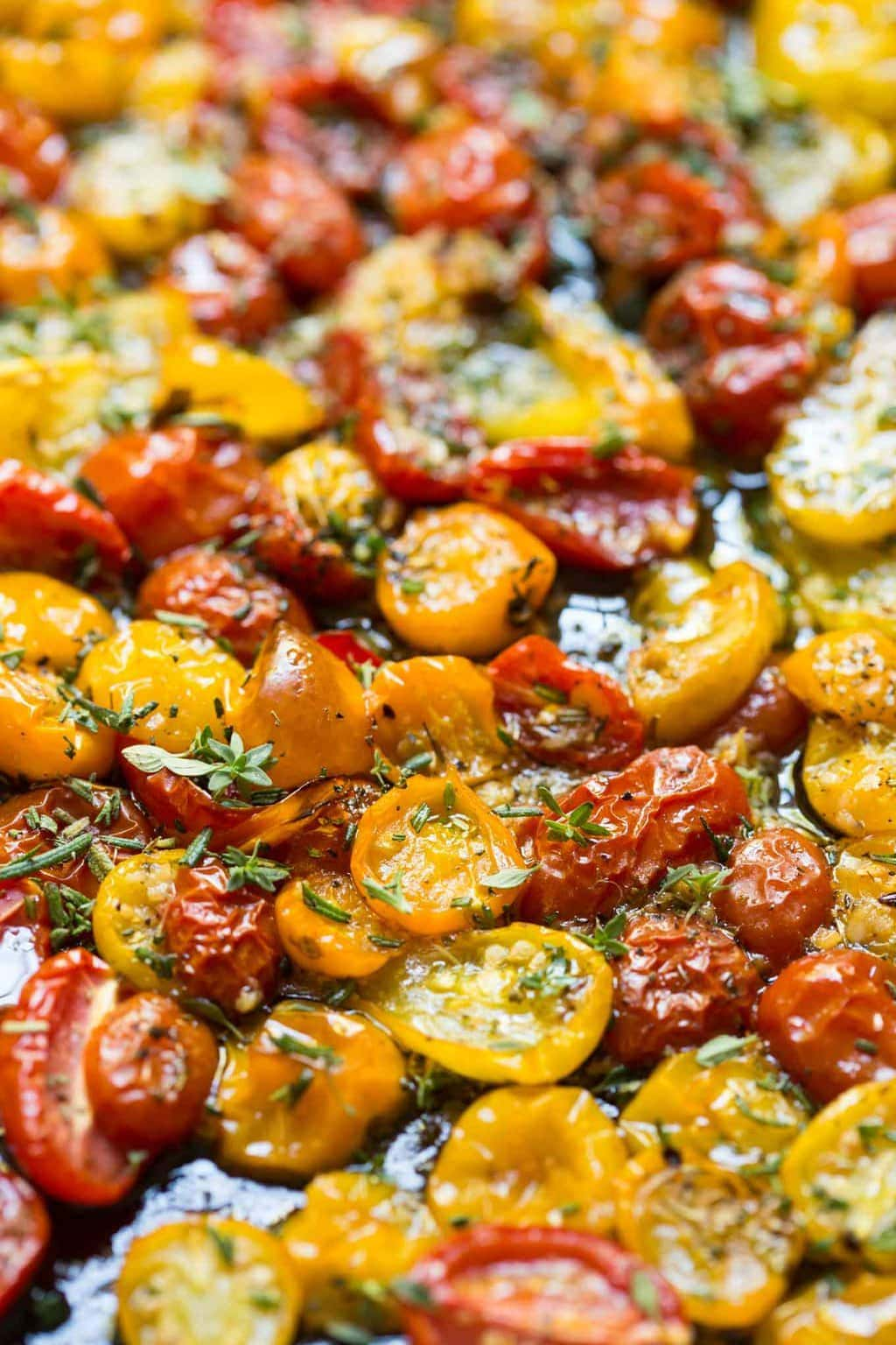 Garlic Herb Roasted Tomatoes - these incredibly flavorful roasted tomatoes are wonderful in salads, pasta dishes, on pizzas, sandwiches and a myriad of other uses! thecafesucrefarine.com