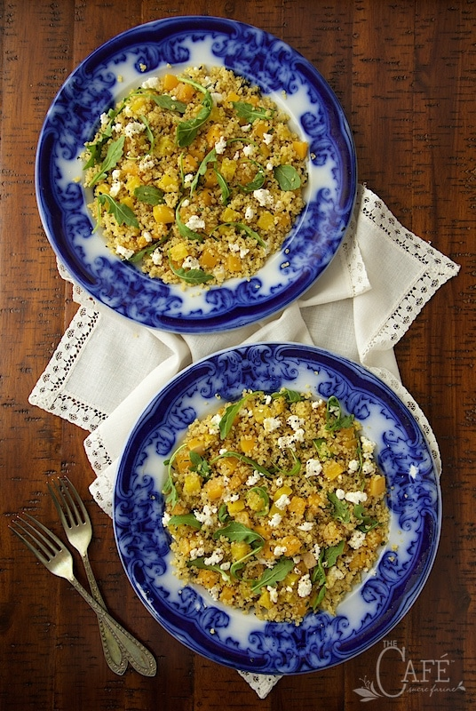 Overhead picture of Golden Beet and Butternut Quinoa Salad on blue and white plates