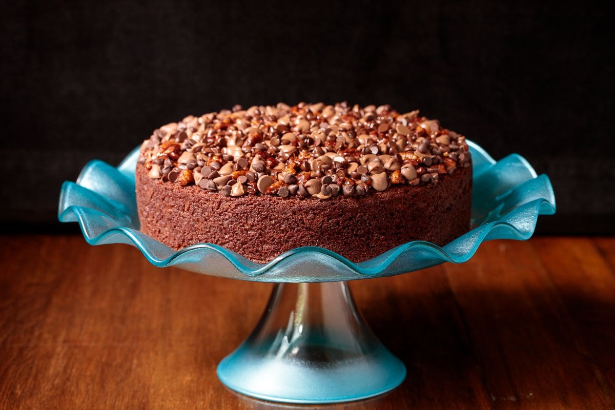 Photo of an Easy Chocolate Yogurt Cake on a decorative turquoise cake stand.