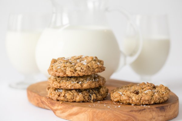 Image of Grannie Annie's Oatmeal Raisin Cookies with pitcher and glasses of milk