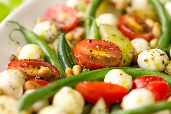 Extreme closeup photo of Green Bean Salad Caprese.