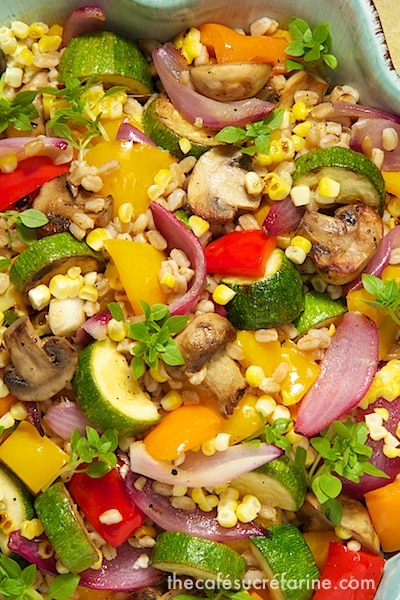 Extreme closeup photo of a dish of Grill Roasted Vegetable Farro Salad.