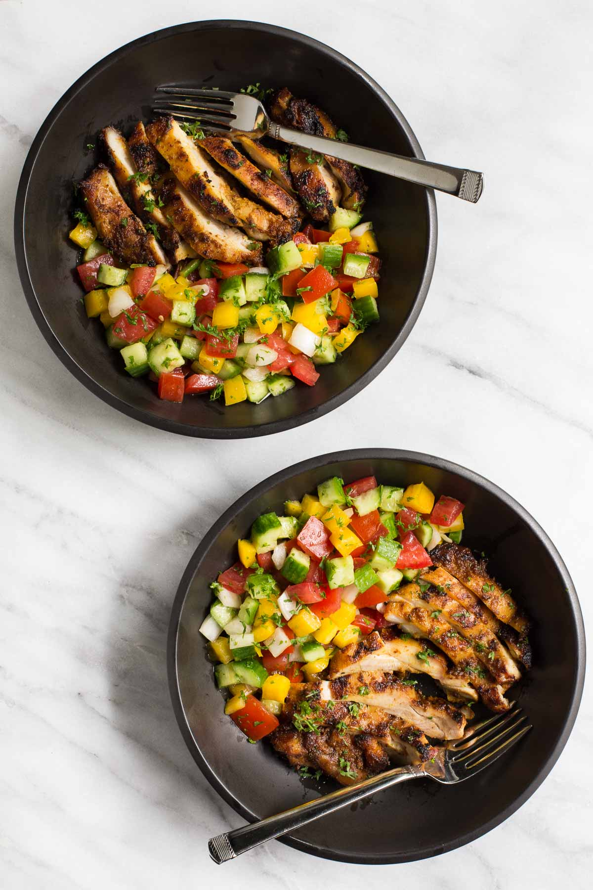 Overhead photo of two black bowls filled with Grilled Chicken Shawarma and