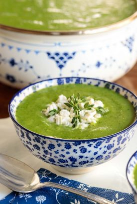 Vertical picture of Ham and Fresh Pea Soup in a blue and white bowl