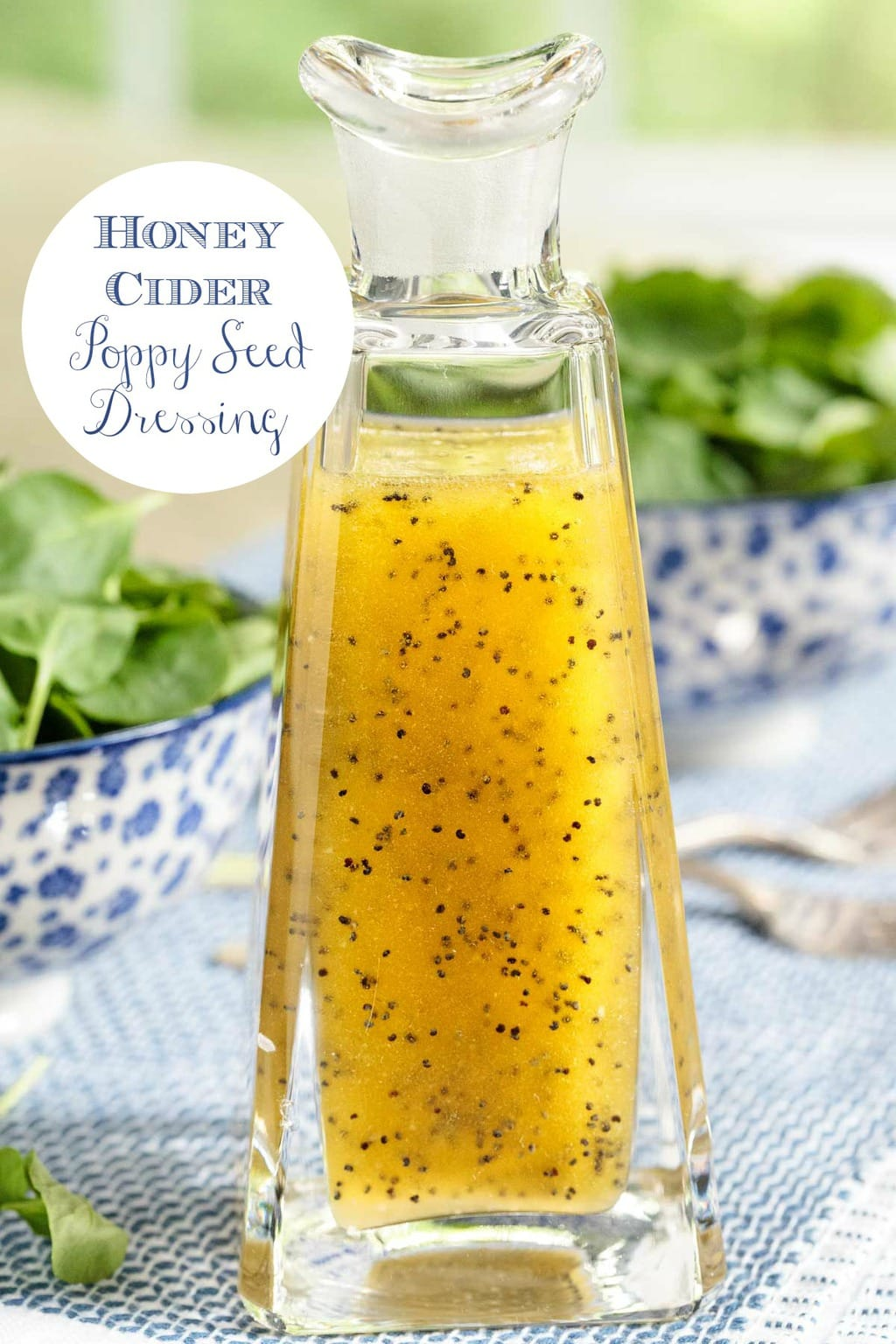 You\'ll find yourself drizzling this delicious, sweet, tangy Honey-Cider Poppy Seed Dressing on a zillion different kinds of salads - and lots of other things too! #easydressing, #honeyciderdressing, #spinachsaladdressing