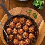 Overhead picture of Huli Huli Chicken meatballs in a cast iron skillet