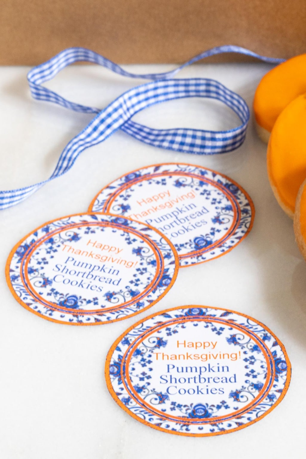 Vertical closeup photo of a set of Happy Thanksgiving Pumpkin Shortbread Cookies.