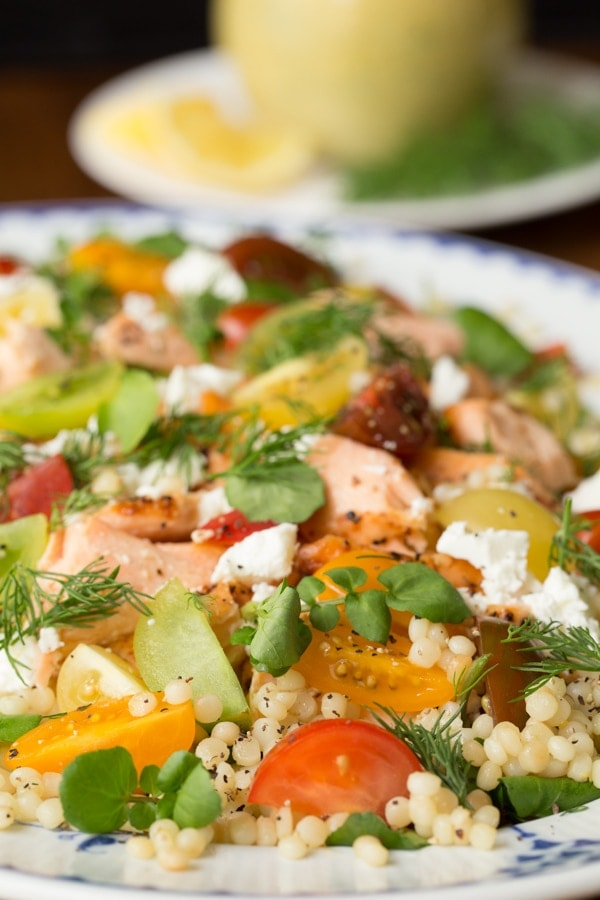 Served warm or at room temperature, this Israeli Couscous Salmon Salad is light, fresh and delicious. It comes together in right around 30 minutes! #salmonsalad #maincoursesalad #healthyrecipes