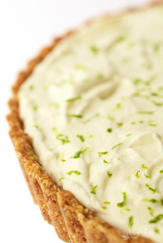 Closeup photo of the top of a Key Lime Crunch Tart decorated with lime zest.