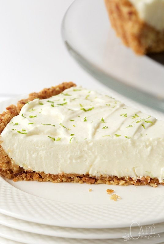 Closeup photo of a slice of Key Lime Crunch Tart on a white serving plate.