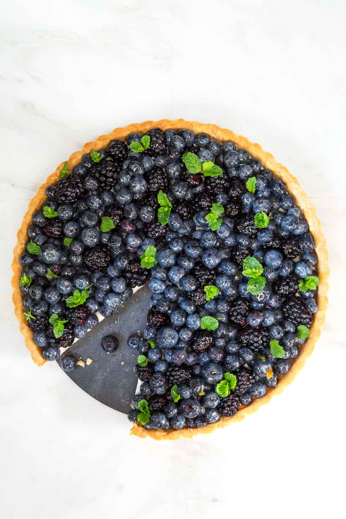 Overhead photo of a Lemon Cheesecake with Glazed Berries.