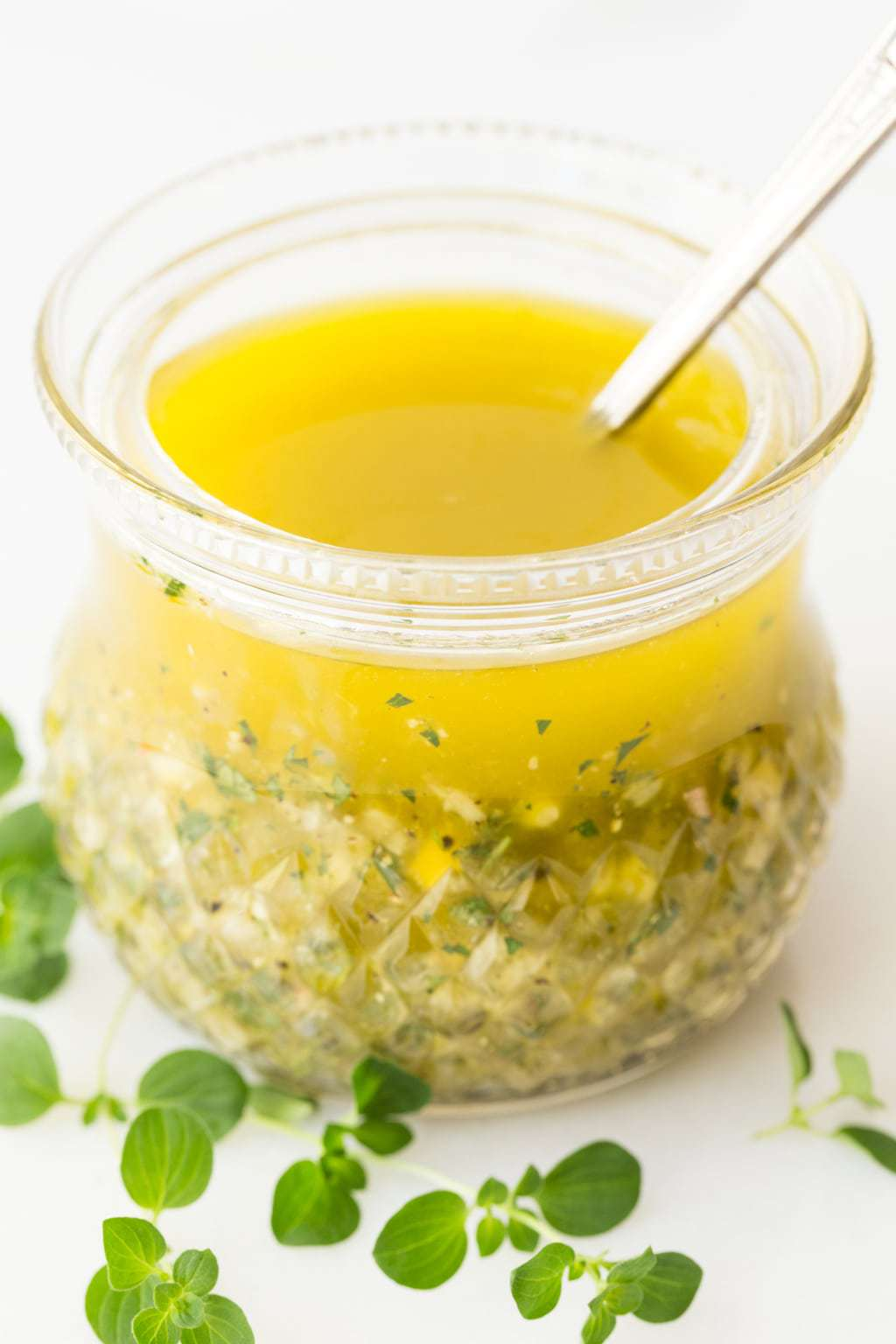 Vertical picture of Lemon Oregano Salad Dressing with a white background
