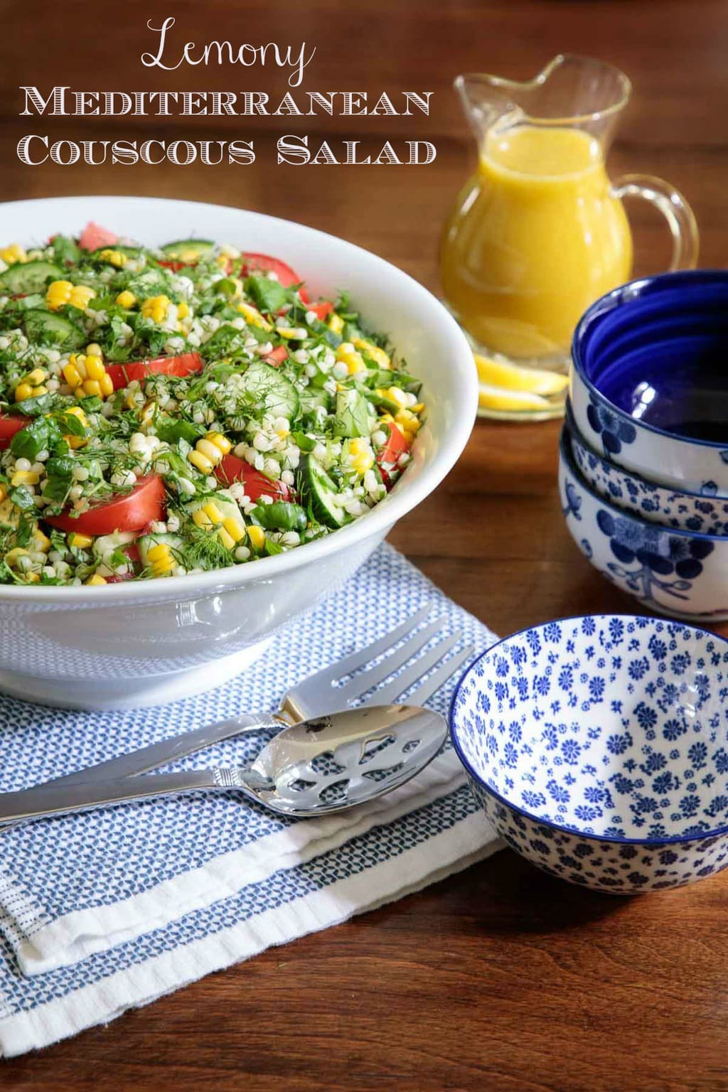 This Mediterranean Couscous Salad combines pearl pasta, crisp cucumbers, juicy tomatoes, tender corn and ribbons of fresh spinach to create a healthy, delicious salad. A sunny lemon dressing and lots of fresh herbs take it over the top! #couscoussalad, #summersalad, #healthysalad, #pastasalad, #lotsofveggies, #freshherbsalad